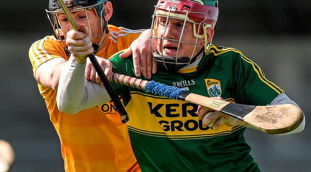Ciaran Clarke of Antrim tackles Kerry's Sean Weir at Parnell Park last Saturday