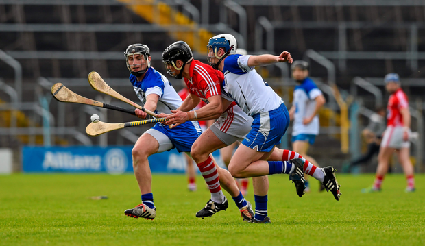 Waterford forwards Pauric Mahony and Stephen Bennett put pressure on Cork defender Shane O'Neill during last Sunday's NHL final in Thurles