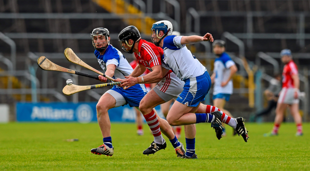 Waterford forwards Pauric Mahony and Stephen Bennett put pressure on Cork defender Shane O'Neill during last month's NHL final in Thurles