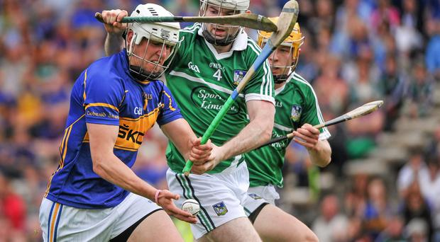 Tipperary's Patrick Bonner Maher carries the fight to Limerick's Tom Condon in last year's Munster semi-final at Semple Stadium.