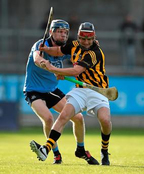 Kilkenny's Mark Mansfield fends off the challenge of Dublin forward Colm Cronin during last night's Bord Gais Leinster U-21 clash at Parnell Park