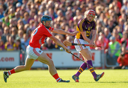 Wexford's Diarmuid O'Keeffe comes under pressure from Conor Lehane of Cork during their qualifier clash last night