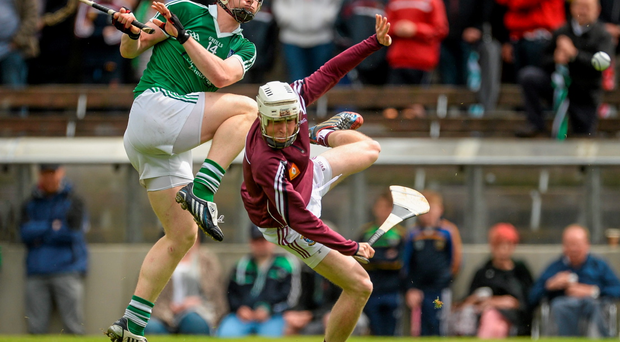 Limerick's Kevin Downes takes aim despite the attention of Westmeath's Shane McGovern in Mullingar yesterday
