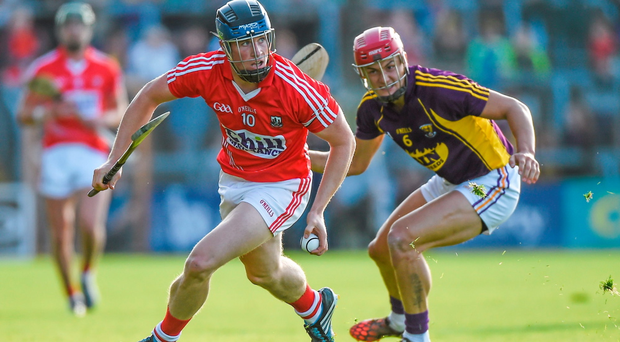 Conor Lehane, Cork, in action against Lee Chin, Wexford