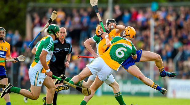 John Conlon, Clare, in action against Colin Egan, Offaly. GAA Hurling All-Ireland Senior Championship, Round 1, Clare v Offaly (Stephen McCarthy / SPORTSFILE)