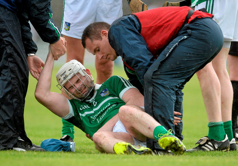 Tom Condon, Limerick, is treated for an injury during Westmeath v Limerick
