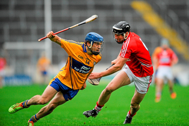 Shane O'Donnell, Clare, in action against Mark Ellis, Cork.
