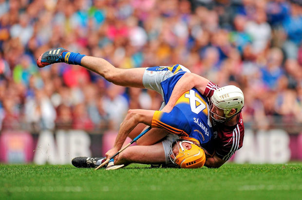 Tipperary sharpshooter Seamus Callanan is hauled to the ground by Galway's John Hanbury, which resulted in a yellow card for the defender and a Tipperary penalty