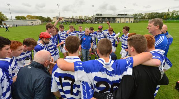 Naas under 16 hurlers listen attentively to a half-time team talk