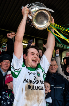 Joseph Cooney lifts the cup after Sarsfields' victory in the Galway SHC final replay last November Photo: Sportsfile