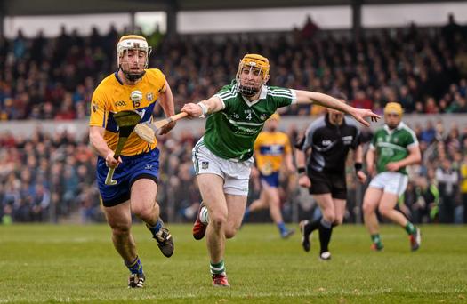 Conor McGrath, Clare, in action against Richie English, Limerick