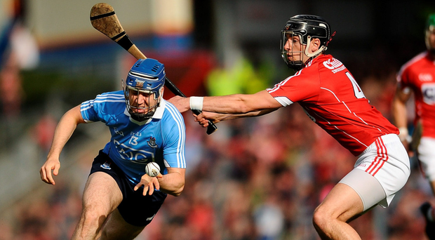Dublin's Paul Ryan gets away from Cork's Killian Burke during yesterday evening's clash, which Dublin lost after being reduced to 14 men after Chris Crummey was sent off late in the first half. Photo: Eóin Noonan/Sportsfile