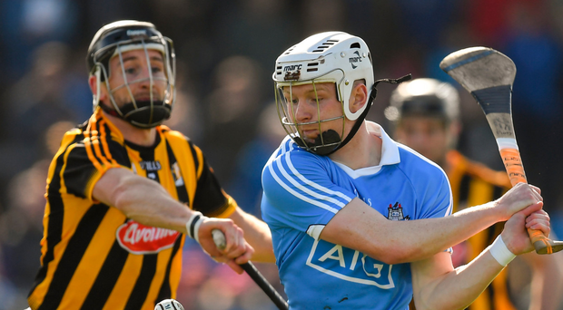 Conor Fogarty of Kilkenny tries to hook Dublin's Fiontán McGibb during yesterday's clash in Parnell Park. Photo: Sportsfile