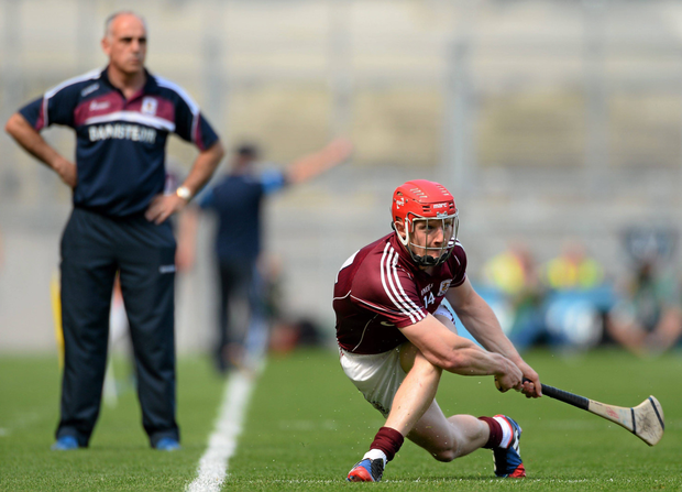 Joe Canning takes a sideline cut in front of then Galway manager Anthony Cunningham in 2013. Photo: Sportsfile