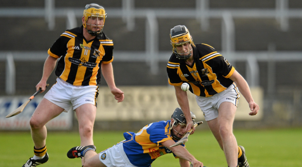 Gearoid Burke of Camross wins possesion ahead of Clough-Ballacolla's Aidan Corby as Tomas Burke looks on during the 2015 Laois SHC final at O'Moore Park Photo: Sam Barnes/Sportsfile