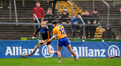 David Reidy of Clare blasts the sliotar past Tipperary goalkeeper Paul Maher for the only goal of the game. Photo: Sportsfile