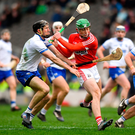 Waterford's Barry Coughlan nips in just as Cork's Robbie O'Flynn is about to pull the trigger during yesterday's Allianz Division 1A clash Photo: Sportsfile