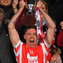 Cuala captain Paul Schutte lifts the cup. Photo: Sportsfile