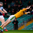 Kevin Downes shoots to score Na Piarsaigh's first goal despite the best efforts of Clonoulty/Rossmore goalkeeper Declan O'Dwyer. Photo: Sportsfile