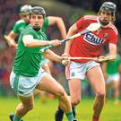 Limerick's Peter Casey attempts to get away from Cork's Robert Downey as the All-Ireland champions suffered a surprising defeat last time out. Photo: Sportsfile