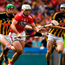 Kilkenny's Joey Holden hunts down Cork's Patrick Horgan. Holden's switch back to play as a sweeper turned the tide for the Cats. Photo: RAY MCMANUS