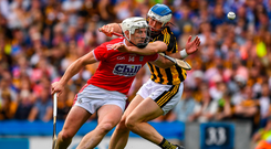 Cats win dogfight: Patrick Horgan finds his way to goal blocked by Kilkenny's Huw Lawlor. Photo: Sportsfile