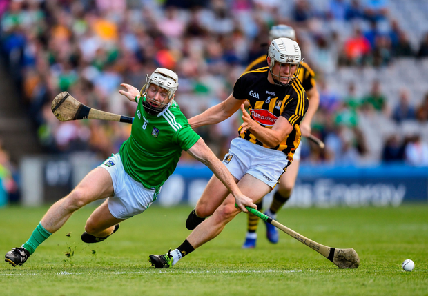 Limerick's Cian Lynch tussles with Conor Browne of Kilkenny. Photo: Ray McManus/Sportsfile