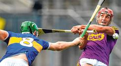 Relentless : Tipperary's Noel McGrath blocks a shot by Wexford's Lee Chin. Photo: Brendan Moran/Sportsfile