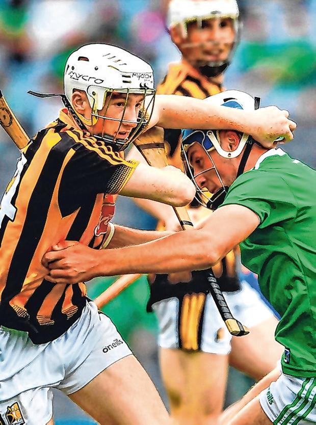 Kilkenny's Timmy Clifford fends off the challenge of Ethan Hurley. Photo: Ray McManus/Sportsfile
