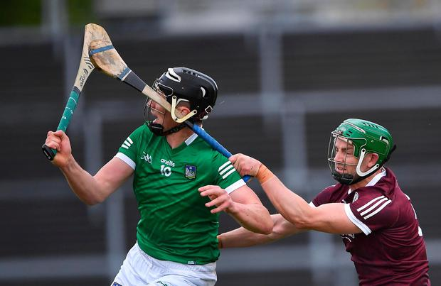Adrian Tuohey of Galway tackles Limerick's Gearóid Hegarty during Sunday's game. Photo: Piaras Ó Mídheach/Sportsfile
