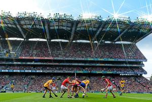Cork and Clare players attempt to gain possession during the 2013 All-Ireland Senior Championship final replay