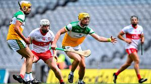 Killian Sampson of Offaly gathers possession ahead of Odhran McKeever of Derry during the Christy Ring Cup final at Croke Park. Photo by Piaras Ó Mídheach/Sportsfile