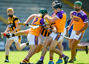 Shelmaliers' James Cash gets up close and personal with Faythe Harriers' Wayne Mallon, Paul Murphy and Colm Heffernan during their Wexford SHC quarter-final in Wexford Park. Photo: Sportsfile