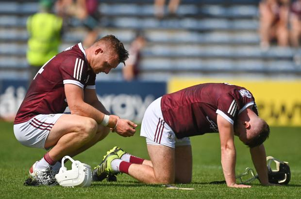 Galway's Joe Canning (left) and Aidan Harte react after their side's defeat defeat to Waterford at Semple Stadium in Thurles. Photo: Harry Murphy/Sportsfile