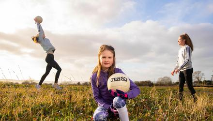 Ellie O'Connor with sisters and Waterford senior county players Aoife and Emma Murray at the site of the WLGFA development. Photo: Patrick Browne