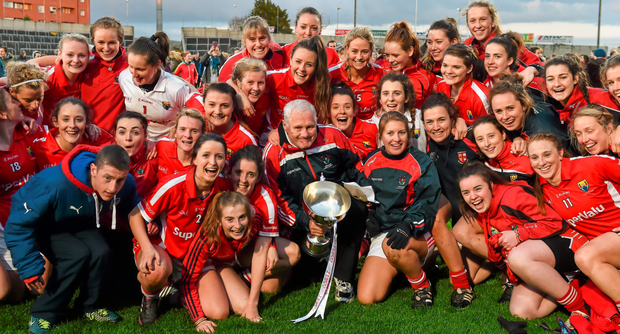 The Cork team celebrate with the cup after winning the TESCO HomeGrown Ladies NFL final replay against Galway BRENDAN MORAN / SPORTSFILE