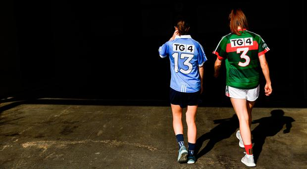 Dublin's Sinead Aherne and Mayo's Sarah Tierney. Photo: Ramsey Cardy.