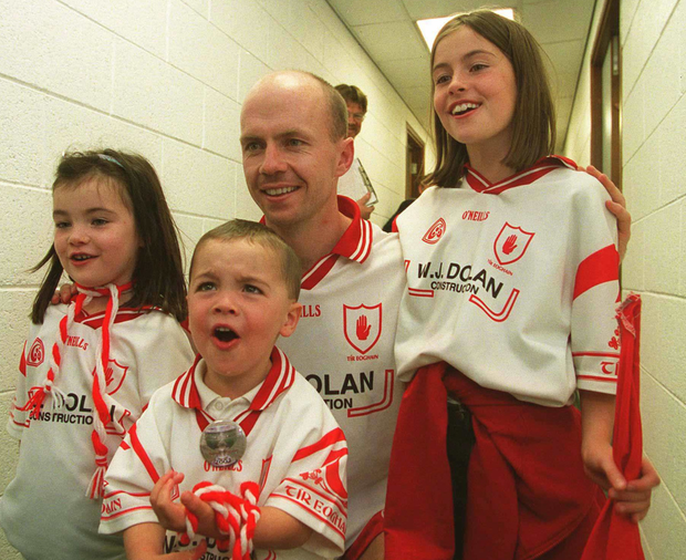 Peter Canavan with his children Áine, right, Claire and Darragh after victory over Armagh in 2003. Photo: Brendan Moran / Sportsfile