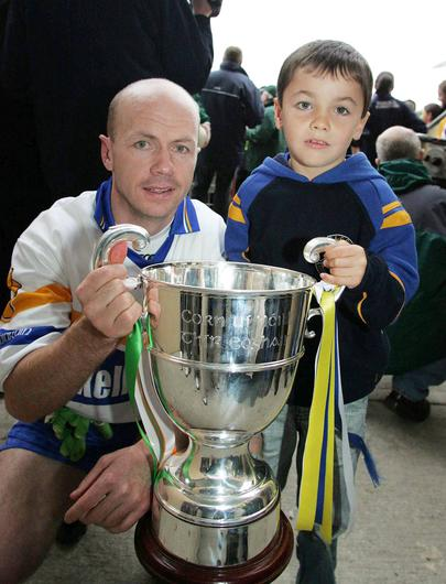 Errigal Ciaran captain Peter Canavan and his son Darragh hold the O'Neill Cup in 2006. Picture credit: Oliver McVeigh / SPORTSFILE