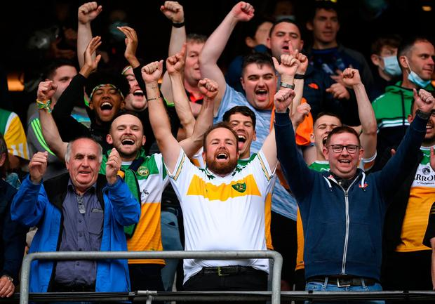Golfer and Offaly supporter Shane Lowry, centre, celebrates after Offaly lift the U20 All-Ireland football title