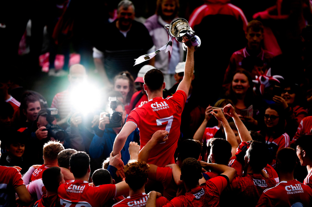 Peter O'Driscoll and team-mates celebrate with the trophy following Cork's victory over Dublin in the All-Ireland Under 20 football championship final yesterday. Photo: Sportsfile