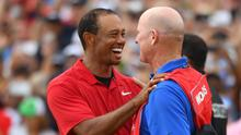 Tiger Woods celebrates with his caddy, Joe LaCava. Photo: USA TODAY Sports