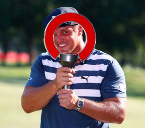 Bryson DeChambeau celebrates with the trophy after winning the Rocket Mortgage Classic at the Detroit Golf Club. Photo: Getty Images