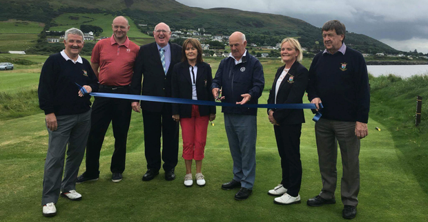 Gavin Caldwell, captain of the Royal and Ancient, formally opens the new fourth hole at North West to coincide with the club's 125th anniversary