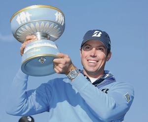 Matt Kuchar celebrates with the trophy after defeating Hunter Mahan during last year's final GETTY