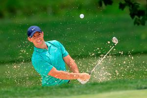 Rory McIlroy plays from a bunker at the fourth hole of his first round at the Memorial Tournament