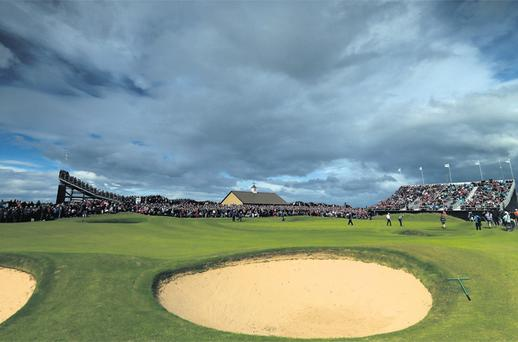 The magic of Royal Portrush is captured by this picture of the 18th hole, with spectators packed around the green in record numbers