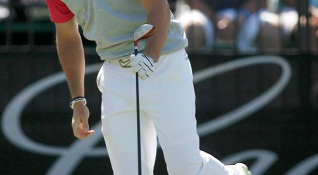 Rory McIlroy reacts to his tee shot on the 10th hole