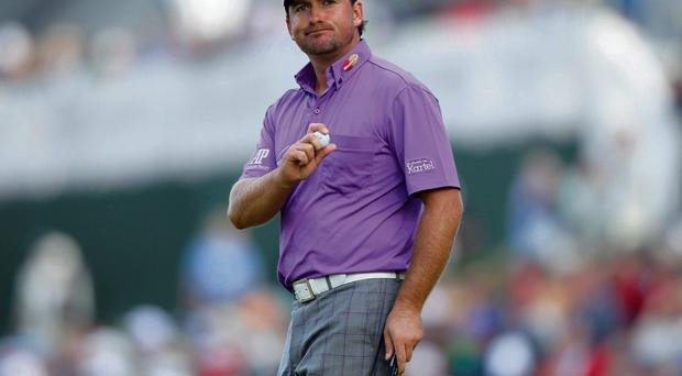 Graeme McDowell of Northern Ireland reacts after holing out on the 17th hole during the third round of the 2012 U.S. Open golf tournament on the Lake Course at the Olympic Club in San Francisco...Graeme McDowell of Northern Ireland reacts after holing out on the 17th hole during the third round of the 2012 U.S. Open golf tournament on the Lake Course at the Olympic Club in San Francisco, California June 16, 2012. REUTERS/Danny Moloshok (UNITED STATES - Tags: SPORT GOLF) ...S