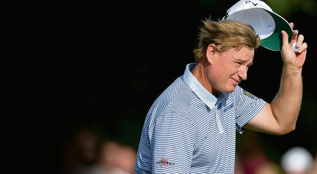 Ernie Els acknowledges the crowd on the 18th green during the second round of the BMW International Open
